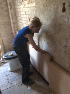 Alex Jelly installing wood-fibre insulation 2