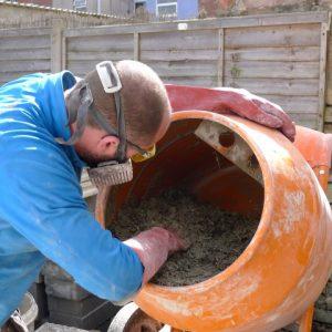 Mixing hempcrete in a drum mixer